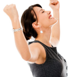 Excited business woman celebrating a triumph - isolated over a white background